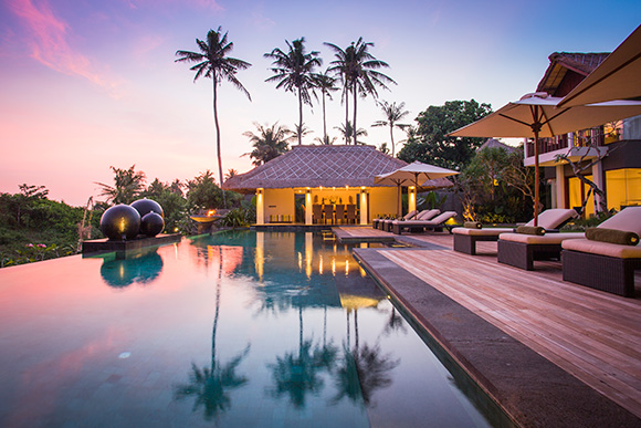 The enormous swimming pool is the centre of attention in Seseh Beach Villa.