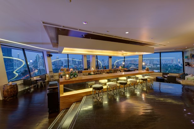 22 Bar and Restaurant Views over the park and city from the rooftop with a roof.
