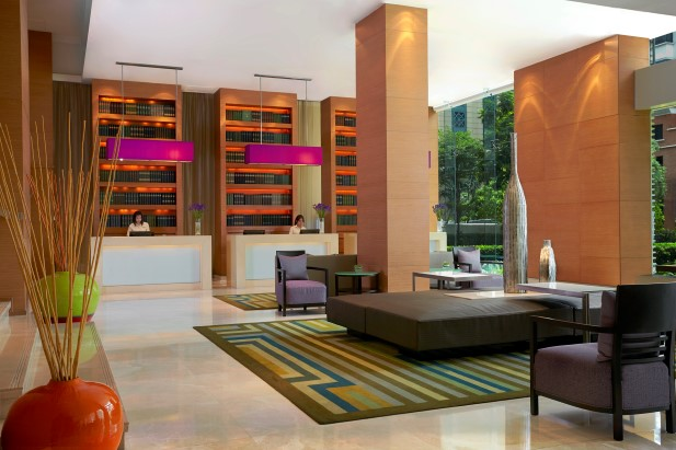Welcome! Polished marbel and faux book shelf set the style of the lobby and reception.